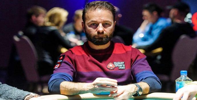 Daniel Negreanu playing poker in Poker Stars sweater