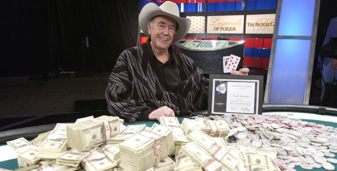 Doyle Brunson with table full of money he won in poker