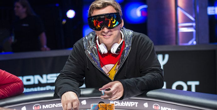 Phil Laak at the poker table wearing ski glasses